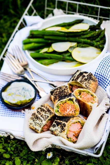 Salmon and avocado rolls with asparagus salad and dill yoghurt